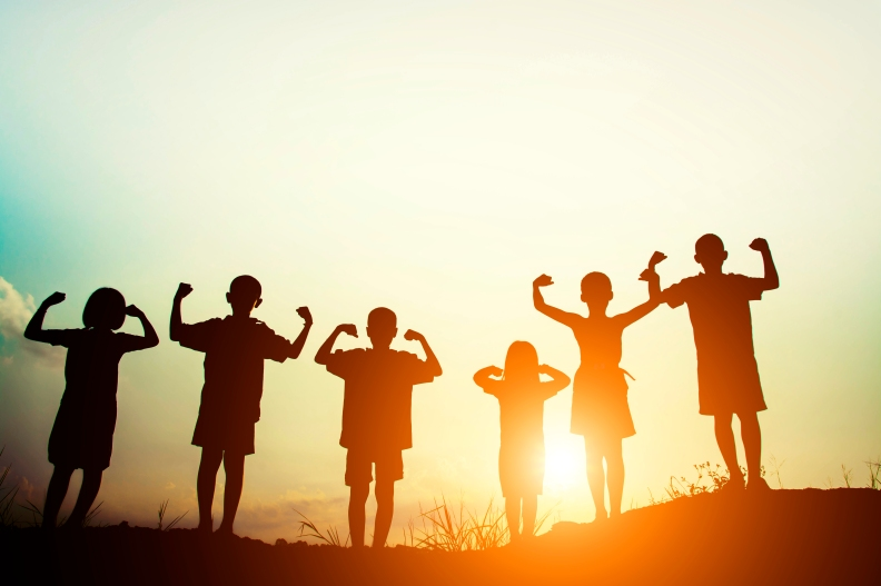 silhouette of a happy children and happy time with sunset.